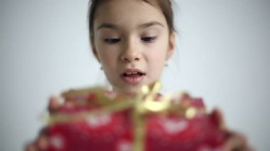 Female child receives a gift surprised and glad. Slow motion. — Stock Video
