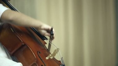 Female child playing the cello — Stockvideo