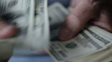 A businessman's hands counting hundred dollar bills at a table — Stock Video