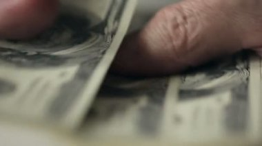 Close up a businessman's hands counting hundred dollar bills at a table. Slow motion — Stock Video