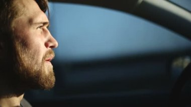 A man drives a car. Close up profile shot — Stock Video