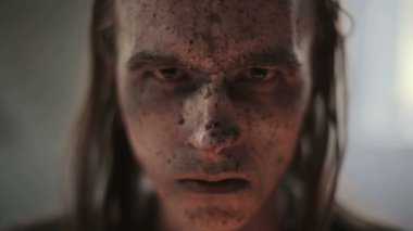 Portrait of a military man's face in blood and dirt — Stock Video