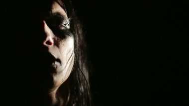 Vocalist of black metal band. Close up face at dark background — Stock Video