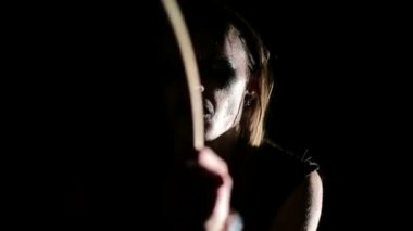 Drummer of black metal band. Close up face at dark background — Stock Video
