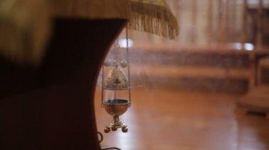 Smoldering incense in Christian church — Stock Video