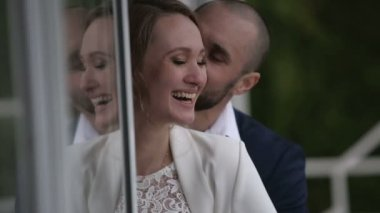 Family couple on veranda of their home — Stock Video