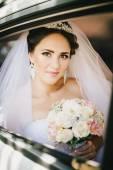 Beautiful bride in a car — Stock Photo