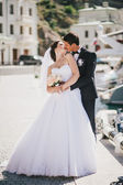 Just married couple walking in small cove — Stock Photo