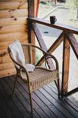 Wicker chair on a cosy balcony — Stock Photo