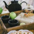 Homemade apple pie, apples and autumn leaves on the wooden table — Stock Photo #54246713