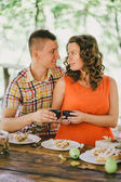 Pregnant woman having lunch with her husband in a forest — Stock Photo
