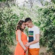 Young pregnant woman with her husband holding hands on her belly — Stock Photo #54779679