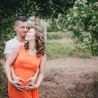 Young pregnant woman with her husband holding hands on her belly — Stock Photo #54779721