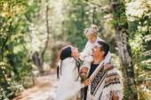 Happy family in an autumn forest — Стоковое фото