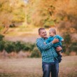 Father and his little son walking in an autumn forest — Stock Photo #55855135