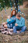Happy family have birthday party with blue decorations in forest — ストック写真