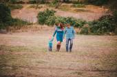 Happy family in blue stylish clothes walking in autumn forest — Stock fotografie