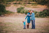 Happy family in blue stylish clothes walking in autumn forest — Foto Stock