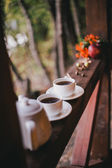 Cups with fresh tea standing on a balcony — Stock Photo