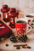Christmas still life with XMAS letters, tea and present — Stock Photo