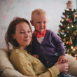 Mother and little son at home near Christmas tree — Stock Photo #59023221