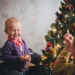 Mother and little son at home near Christmas tree — Stock Photo #59023315