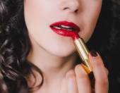 Young beautiful woman with perfect skin using red lipstick — Stock Photo