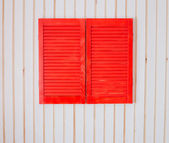 Red wooden shutters on a white wall — ストック写真