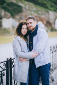 Attractive young couple hugging on the street — Stock Photo