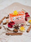 Natural soap with cinnamon and anise stars on a brown paper — Stock Photo