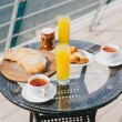 Breakfast for two persons on a balcony with beautiful sea view — Stock Photo #71881603