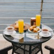 Breakfast for two persons on a balcony with beautiful sea view — Stock Photo #71881671
