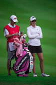 Paula Creamer with Caddy watches lines up — Stock Photo