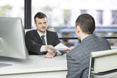 Job candidate handing CV to manager — Stock Photo