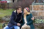 Romantic couple in embrace on a bench — Stockfoto