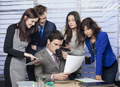 Business people looking at document curiously — Stock Photo