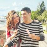 Happy couple outdoors eating ice cream — Stock Photo #52463843