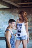 Fashion portrait of young man and woman in tank tops — Stock Photo