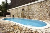 Modern residence swimming pool — Stock Photo