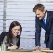 Businesswoman happily signing a document for business partner — Stock Photo #52890173