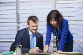 Businesswoman showing businessman where to sign — Stock Photo