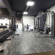 Modern gym interior with various equipment — Stock Photo #53041219