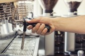 Barista working the coffee machine — Stock Photo