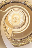 Spiral staircase with chandelier shot from below — Foto de Stock