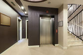 Elevator and stairs in hotel building — Stock Photo