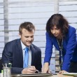 Businesswoman showing businessman where to sign — Stock Photo #53972569
