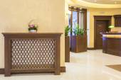Hotel lobby with heater in wooden cover — Stockfoto