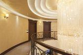 Luxury building corridor with big crystal chandelier — Stock Photo