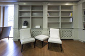 Hotel lobby with bookshelves and chairs — ストック写真