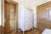 Antique cupboard in a room — Stok fotoğraf